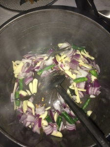 Now add onion, green chilies and garlic.