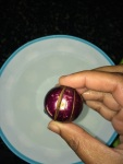 Turn the brinjal upside down and make slits perpendicular to the first done slits.