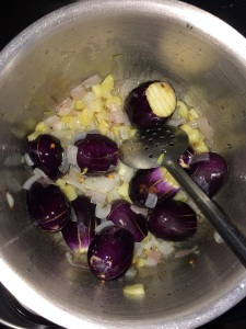 After the onions and garlic get cooked add the brinjals.
