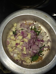 Now add the chopped onion and garlic and saute.