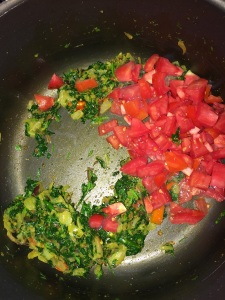 After the methi leaves wilt its water add the chopped tomatoes.