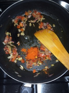 After the tomatoes get mushy add the red chili powder.