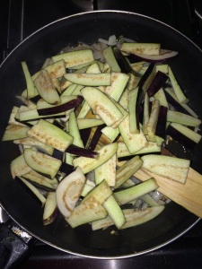Now drain the cut brinjal and add them.