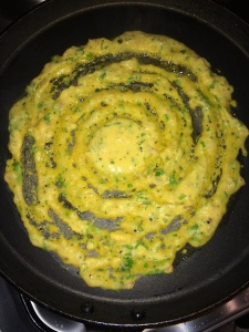 Heat a non stick tawa and make a dosa using the batter. Spread a tsp. of oil.