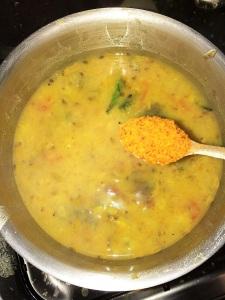 Add sambar masala to the sambar and bring it to a boil.