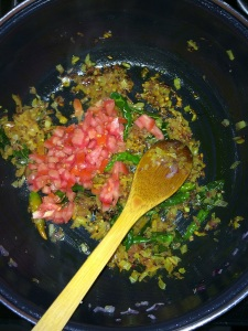 After the onion gets cooked add the finely chopped tomatoes.