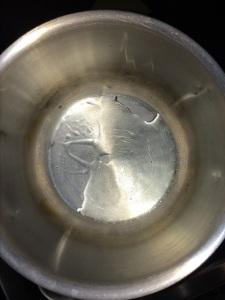 Take little oil in a vessel.