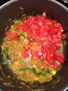 Add the chopped tomatoes after the onion gets cooked well.