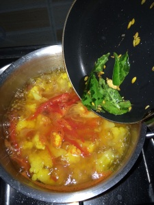 add the tempered mixture to the soup and give it a quick boil.