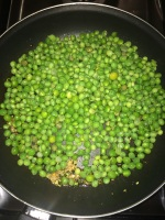 Now add the peas to the pan.