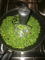 Use a potato crusher and crush the peas.