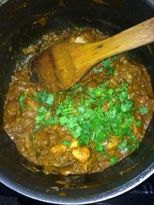 After the curry becomes thick add the chopped coriander leaves and give it a stir.