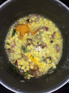 Add the cooked toor dal , turmeric and sambar powder.