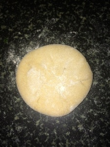 Flatten the dough (with the stuffing using your fingers spreading the stuffing evenly to the corners of the dough.