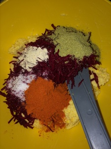 Now add the grated beetroot along with hing, fennel powder, salt, red chili powder and turmeric.