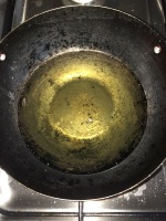 Heat oil in a vessel for deep frying the vada's.