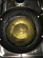 Check the temperature of the oil by adding a little piece inside it.