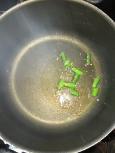 Add the green chilies and fry them.