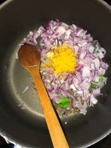 Now add the onion and turmeric and saute till translucent.