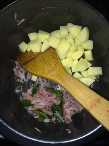 After the onions become translucent add the chopped potato. Saute for few mins.