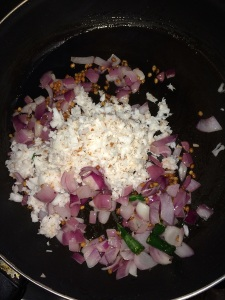 Now add the grated coconut and fry till a nice aroma comes from the coconut.
