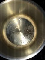 Take oil in a vessel and temper mustard.