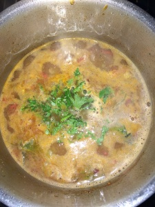 Finally add coriander leaves and serve with hot rice.