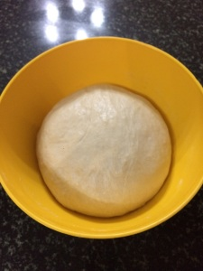 After one hour the dough has doubled in size.Now punch down the air and the dough is ready to make pizzas.