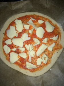 Spread the cheese evenly over the pizza.