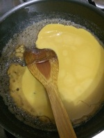Now add the besan ghee and oil mixture and cook in a medium flame.