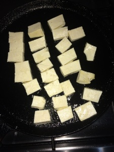 Take a tawa and add oil to it and place the tofu pieces in medium flame and wait for it to get grilled.