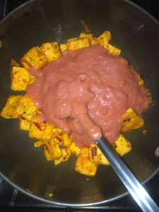Now add the blended onion tomato mixture to the tofu.
