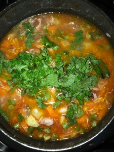 Finally add the chopped mint and coriander leaves on top and close the pressure cookerafter it comes to a boil.