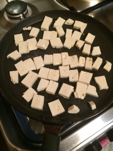 Slice tofu into thin pieces and toast them i na tawa on both sides by adding little oil.
