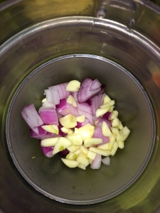 Rough chop the garlic and onion and transfer it into the blender.