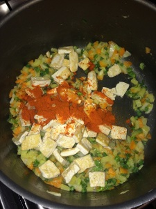 After that add the tofu and red chili powder.