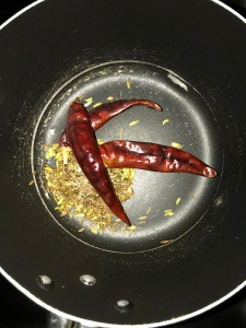 Add the cumin and fennel seeds alng with the dry red chilies. Roast until a nice aroma comes.