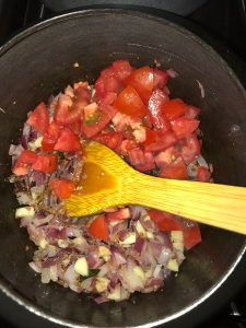 Now add the chopped tomatoes and saute for a minute.